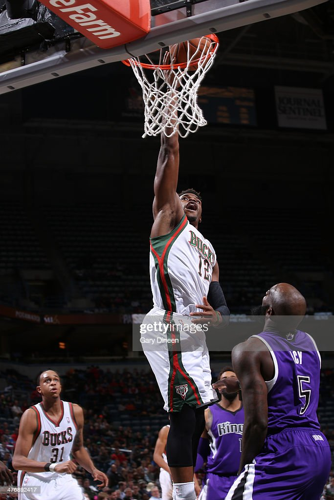 Jeff Adrien #12 of the Milwaukee Bucks shoots against the Sacramento Kings on March 5, 2014 at the BMO Harris Bradley Center in Milwaukee, Wisconsin.