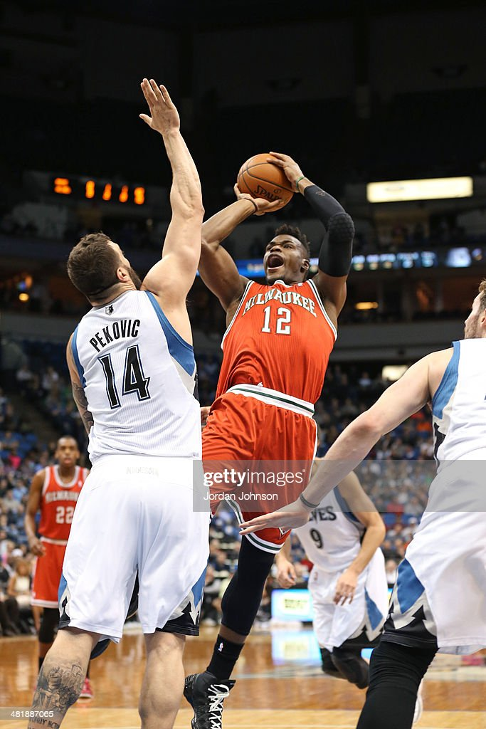 Jeff Adrien #12 of the Milwaukee Bucks shoots the ball during the game against the Minnesota Timberwolves on March 11, 2014 at Target Center in Minneapolis, Minnesota.