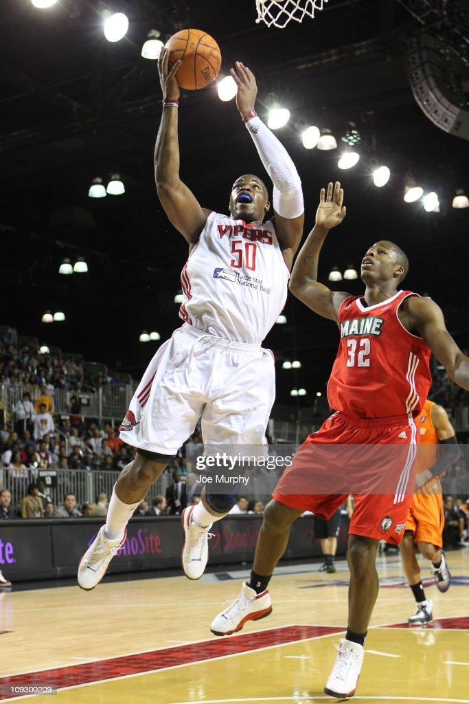 <a gi-track='captionPersonalityLinkClicked' href=/galleries/search?phrase=Jeff+Adrien&family=editorial&specificpeople=727235 ng-click='$event.stopPropagation()'>Jeff Adrien</a> #50 of the West All-Stars shoots the ball over DeShawn Sims #32 of the East All-Stars during the 2011 NBA D-League All-Star Game presented by SonoSite on center court at Jam Session presented by Adidas during NBA All Star Weekend at the Los Angeles Convention Center on February 19, 2011 in Los Angeles, California.
