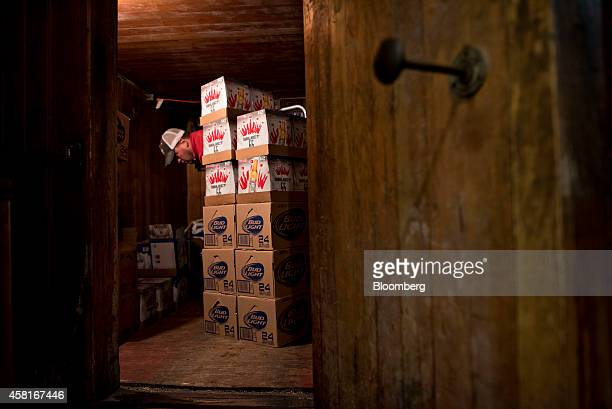 Jeff Allen a delivery driver for Brewers Distributing Co stacks cases of AnheuserBusch beer in the cooler at Roxy Lanes in Pekin Illinois US on...