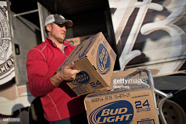 Jeff Allen a driver for Brewers Distributing Co loads cases of Bud Light onto a hand truck as he delivers AnheuserBusch beer to Maquet's Rail House...