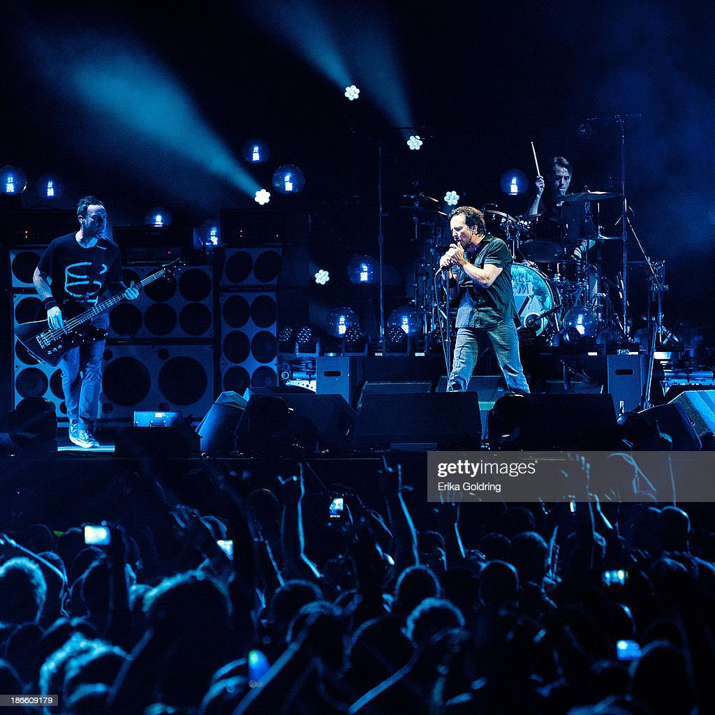 <a gi-track='captionPersonalityLinkClicked' href=/galleries/search?phrase=Jeff+Ament&family=editorial&specificpeople=2540307 ng-click='$event.stopPropagation()'>Jeff Ament</a>, <a gi-track='captionPersonalityLinkClicked' href=/galleries/search?phrase=Eddie+Vedder&family=editorial&specificpeople=208156 ng-click='$event.stopPropagation()'>Eddie Vedder</a> and <a gi-track='captionPersonalityLinkClicked' href=/galleries/search?phrase=Matt+Cameron&family=editorial&specificpeople=4150964 ng-click='$event.stopPropagation()'>Matt Cameron</a> of Pearl Jam perform at the 2013 Voodoo Music + Arts Experience at City Park on November 1, 2013 in New Orleans, Louisiana.