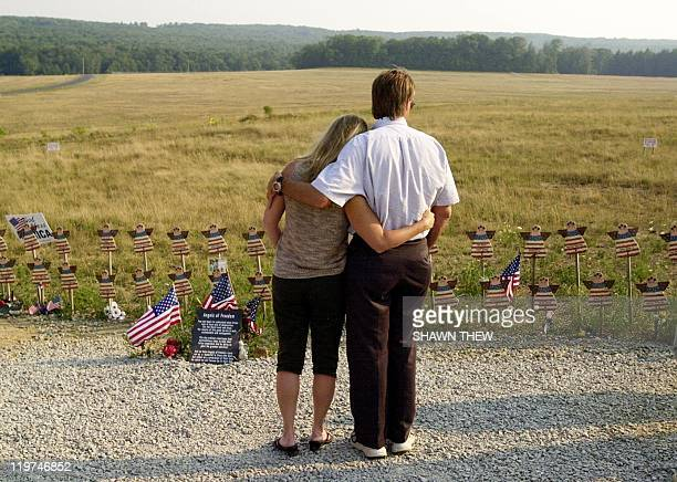 Jeff and Sandy Stewart of Pittsburg PA hug each other 11 August 2002 as they look at angels representing the passengers on Flight 93 at the temporary...