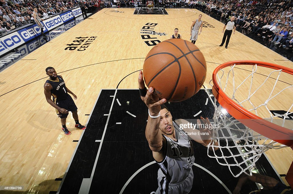 Jeff Ayres #11 of the San Antonio Spurs shoots against the New Orleans Pelicans at the AT&T Center on March 29, 2014 in San Antonio, Texas.