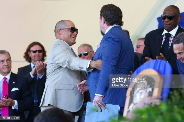 Jeff Bagwell shakes hands with Ivan Rodriguez following his induction speech at Clark Sports Center during the Baseball Hall of Fame induction...