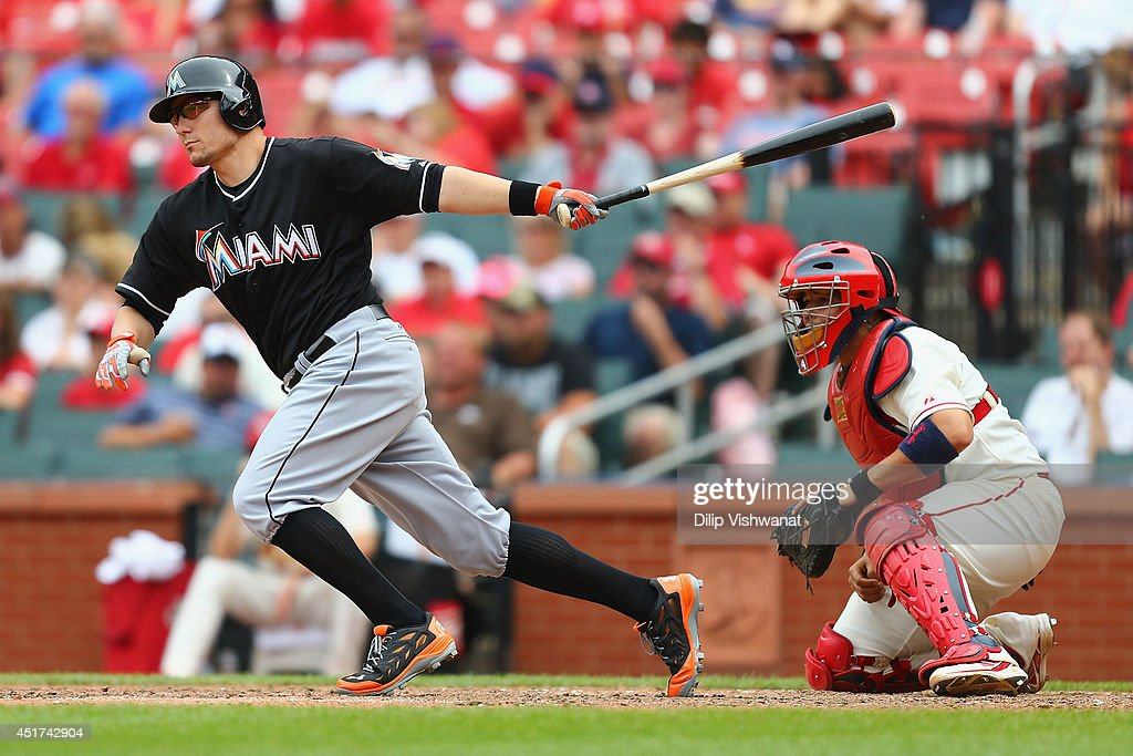 Jeff Baker #10 of the Miami Marlins hits the game-winning RBI single in the ninth inning against the St. Louis Cardinals at Busch Stadium on July 5, 2014 in St. Louis, Missouri. The Marlins beat the Cardinal 6-5.