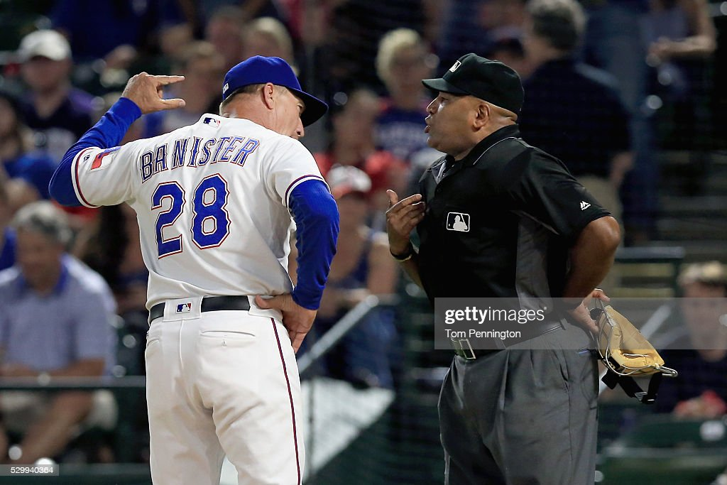Jeff Banister of the Texas Rangers argues with home plate umpire Laz Diaz and is ejected from the game against the Chicago White Sox at Globe Life...