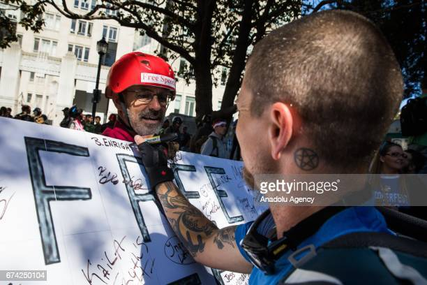 Jeff Barnes of Alameda California invites people to sign a free speech sign during a proDonald Trump rally at Martin Luther King Jr Civic Center Park...