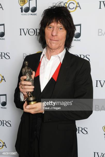 Jeff Beck poses with his 'Outstanding Contribution To British Music' award in the winners room at The Ivor Novello Awards at The Grosvenor House...