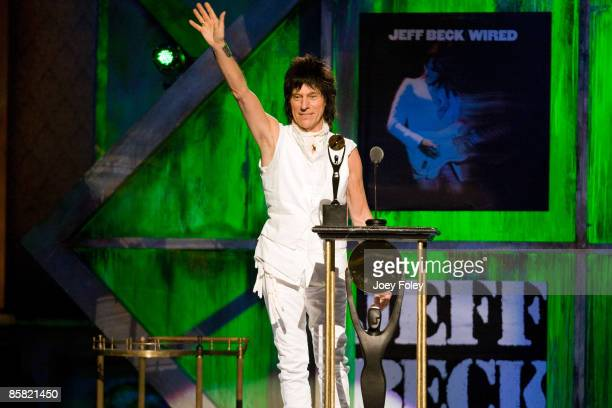 Jeff Beck waves to the crowd onstage during the 24th Annual Rock and Roll Hall of Fame Induction Ceremony at Public Hall on April 4 2009 in Cleveland...