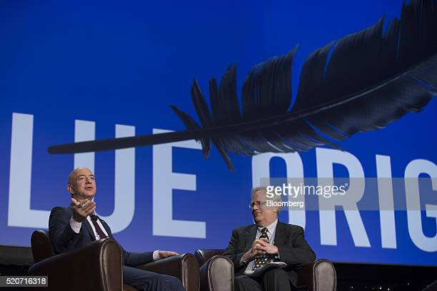 Jeff Bezos chief executive officer of Amazoncom Inc and founder of Blue Origin LLC left speaks during the 32nd Space Symposium in Colorado Springs...