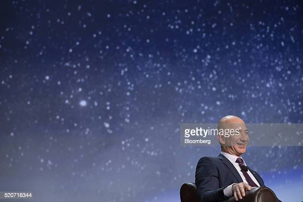 Jeff Bezos chief executive officer of Amazoncom Inc and founder of Blue Origin LLC smiles during the 32nd Space Symposium in Colorado Springs...