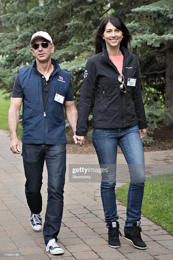 Jeff Bezos, chief executive officer of Amazon.com Inc., left, holds hands with MacKenzie Bezos while arriving for a morning session during the Allen & Co. Media and Technology Conference in Sun Valley, Idaho, U.S., on Thursday, July 11, 2013. Executives from media, finance and politics mingle at the mountain resort between presentations on business trends and social issues, brought together by New York investment banker Herb Allen. Photographer: Daniel Acker/Bloomberg via Getty Images