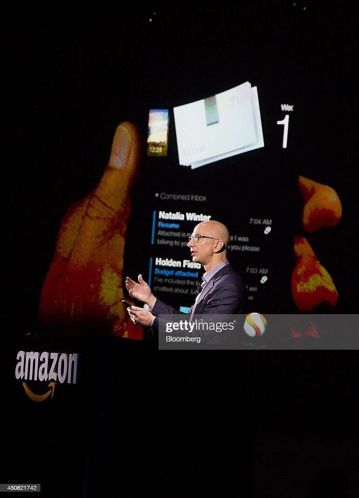 <a gi-track='captionPersonalityLinkClicked' href=/galleries/search?phrase=Jeff+Bezos&family=editorial&specificpeople=217573 ng-click='$event.stopPropagation()'>Jeff Bezos</a>, chief executive officer of Amazon.com Inc., unveils the Fire Phone during an event at Fremont Studios in Seattle, Washington, U.S., on Wednesday, June 18, 2014. Amazon.com Inc. jumped into the crowded smartphone market with its own handset called Fire Phone, ramping up competition with Apple Inc. and Samsung Electronics Co. Photographer: Mike Kane/Bloomberg via Getty Images