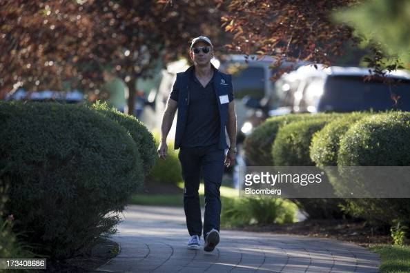 Jeff Bezos chief executive officer of Amazoncom Inc walks to a morning session at the Allen Co Media and Technology Conference in Sun Valley Idaho US...