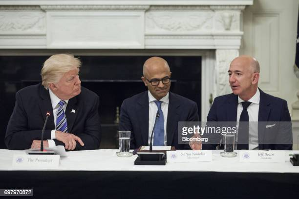 Jeff Bezos president and chief executive officer of Amazoncom Inc right speaks as US President Donald Trump left and Satya Nadella chief executive...