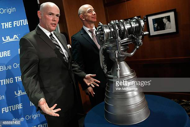 Jeff Bezos the founder of Blue Origin and Amazoncom and Tory Bruno CEO of United Launch Alliance display the BE4 rocket engine during a press...