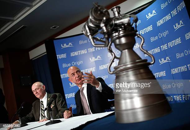 Jeff Bezos the founder of Blue Origin and Amazoncom gestures toward a model of the BE4 rocket engine during a press conference with Tory Bruno CEO of...