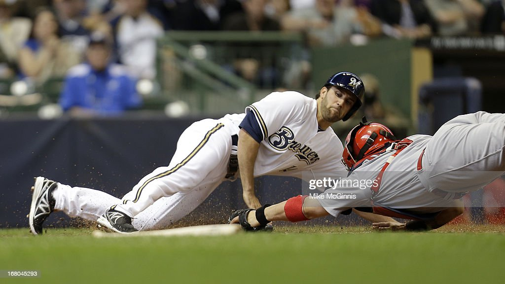 Jeff Bianchi #14 of the Milwaukee Brewers beats the tag at home plate from Yadier Molina #4 of the St. Louis Cardinals during the bottom of the eighth inning at Miller Park on May 04, 2013 in Milwaukee, Wisconsin.