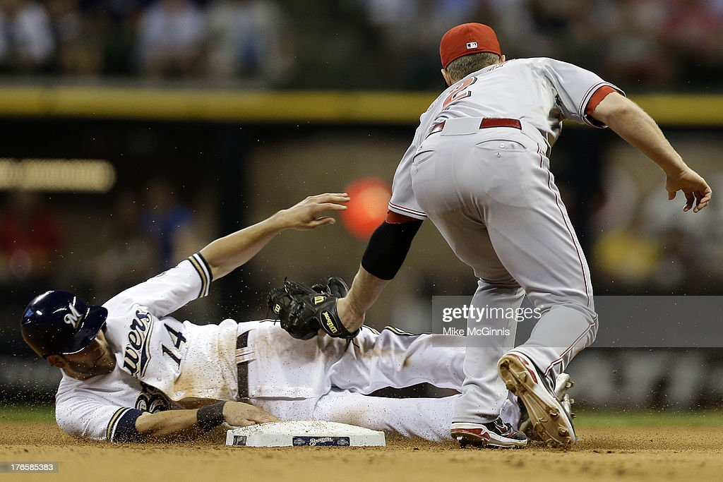 Jeff Bianchi #14 of the Milwaukee Brewers gets tagged out by <a gi-track='captionPersonalityLinkClicked' href=/galleries/search?phrase=Zack+Cozart&family=editorial&specificpeople=6889199 ng-click='$event.stopPropagation()'>Zack Cozart</a> #2 of the Cincinnati Reds while trying to steal second base in the bottom of the eighth inning at Miller Park on August 15, 2013 in Milwaukee, Wisconsin.