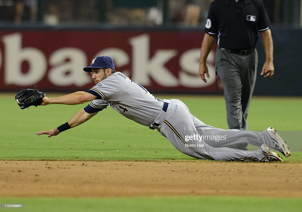 Jeff Bianchi #14 of the Milwaukee Brewers makes a diving play on a ground ball against the Arizona Diamondbacks at Chase Field on July 14, 2013 in Phoenix, Arizona.