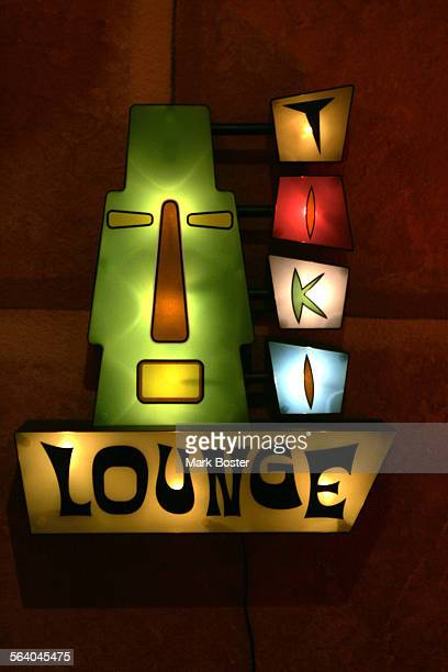 –Jeff 'Biff' Butler enjoys the tiki life to its fullest in his Westminster home Biff found this tiki lounge lamp and displays it near his bar...