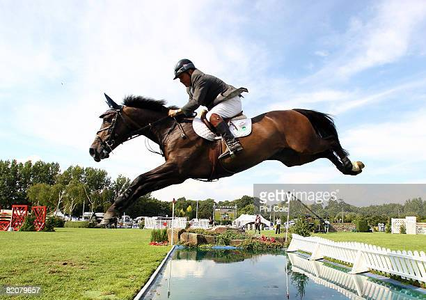 Jeff Billington riding Rosinus clears the water jump in the Longines King George V Gold Cup on July 27 in Hickstead England