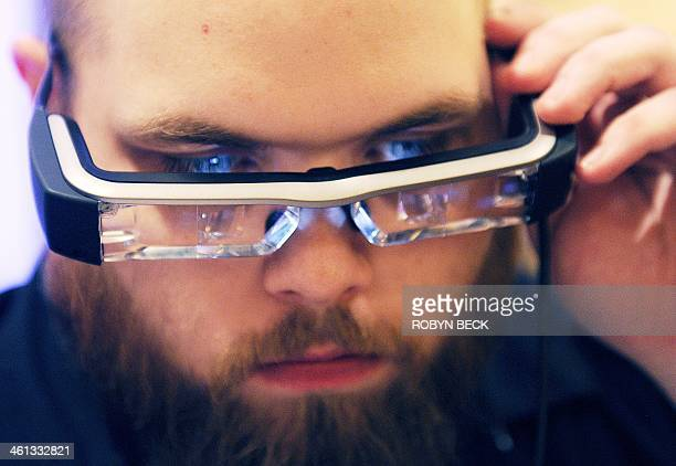 Jeff Boleman tries the Epson Moverio BT200 smart glasses at the 2014 International CES in Las Vegas Nevada January 7 2014 The Moverio BT200 projects...