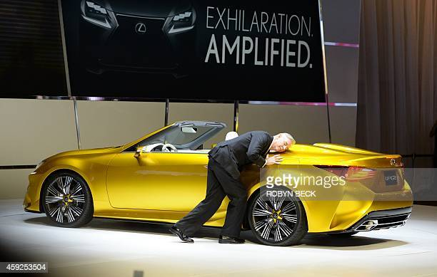 Jeff Bracken Lexus group vice president and general manager expresses his affection for the Lexus LFC2 Concept car by getting close to it and saying...
