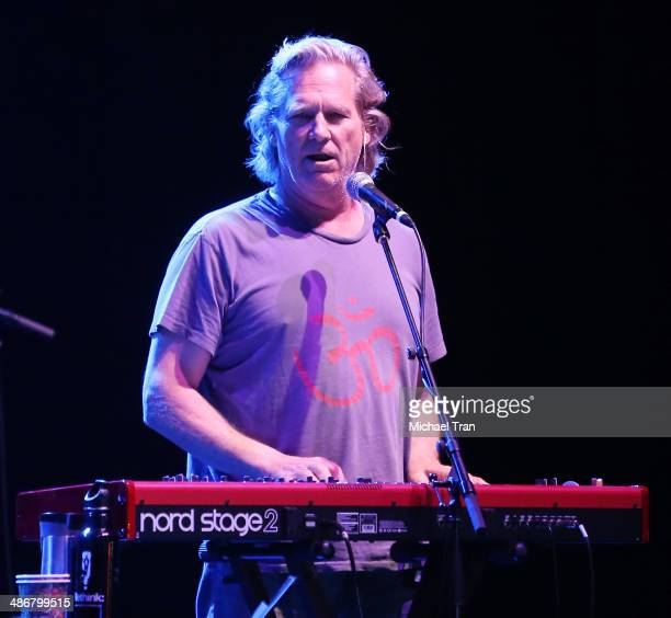 Jeff Bridges performs onstage during the 2014 Lebowski Fest held at Wiltern Theatre on April 25 2014 in Los Angeles California