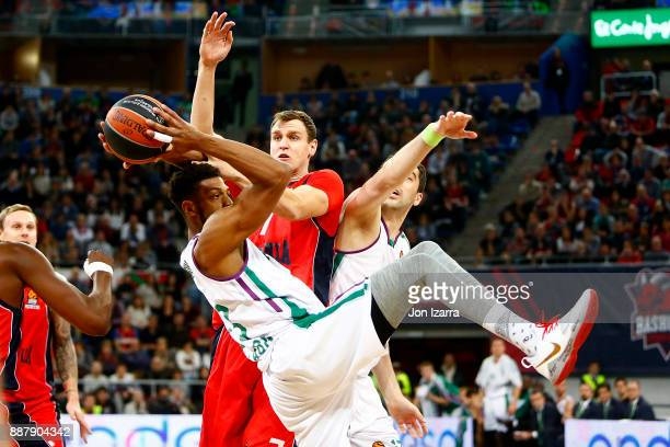 Jeff Brooks #23 of Unicaja Malaga competes with Johannes Voigtmann #7 of Baskonia Vitoria Gasteiz in action during the 2017/2018 Turkish Airlines...