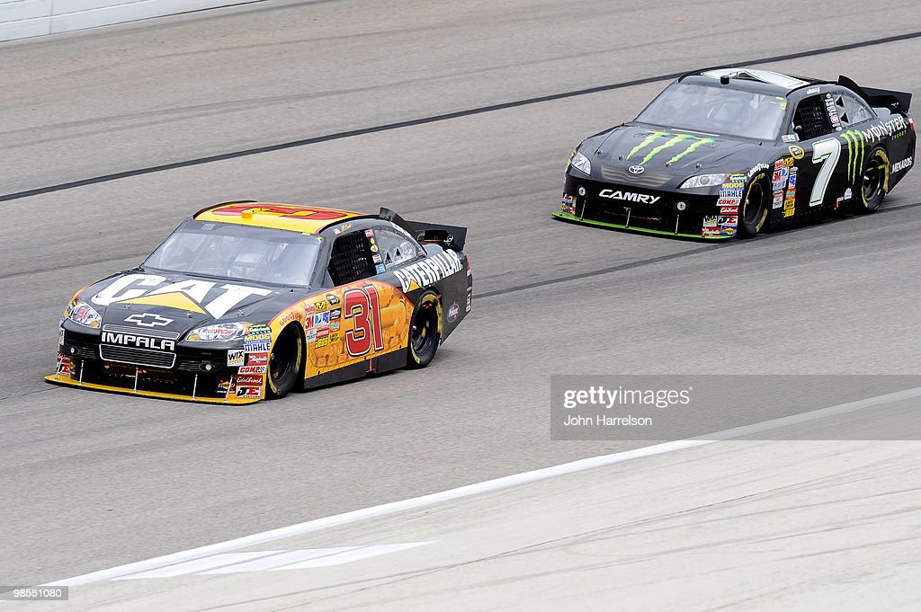 Jeff Burton driver of the Caterpillar Chevrolet leads Robby Gordon driver of the Monster Energy Toyota during the NASCAR Sprint Cup Series Samsung...