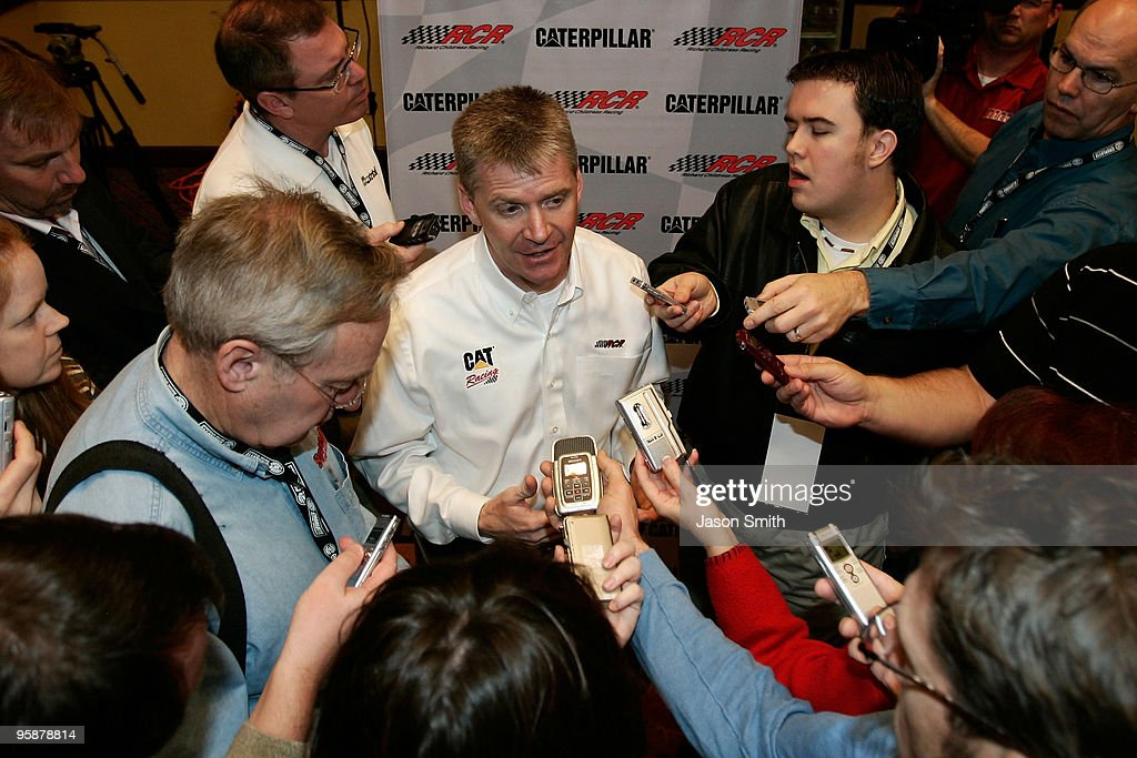 Jeff Burton driver of the Caterpillar Chevrolet speaks with the media during the NASCAR Sprint Media Tour hosted by Charlotte Motor Speedway and held...