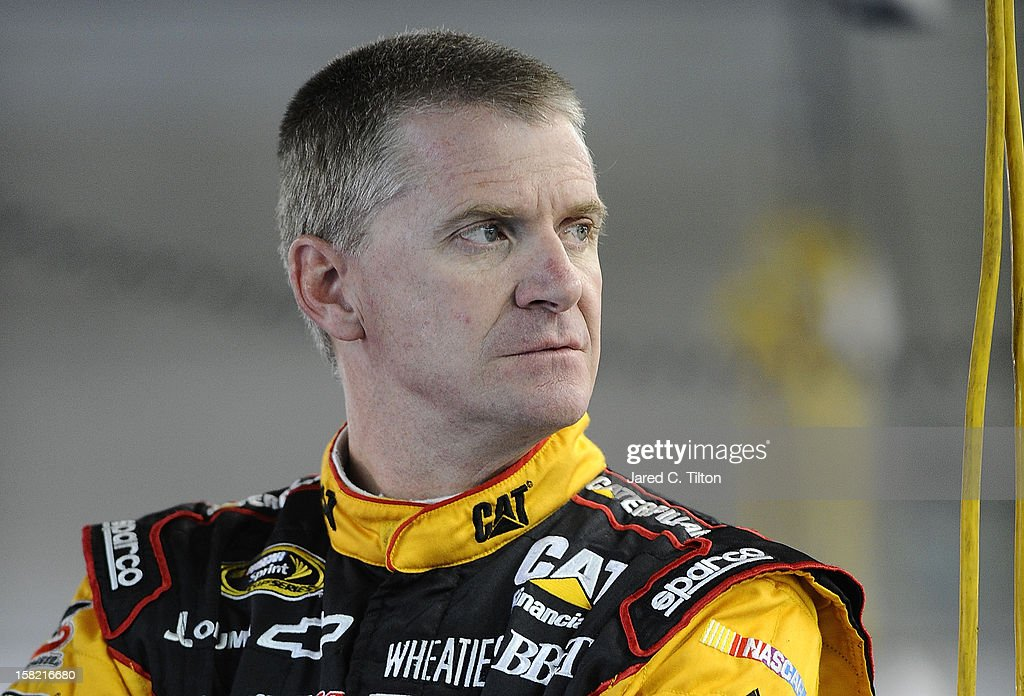 Jeff Burton, driver of the #31 Caterpillar Chevrolet, stands in the garage area during testing at Charlotte Motor Speedway on December 11, 2012 in Concord, North Carolina.