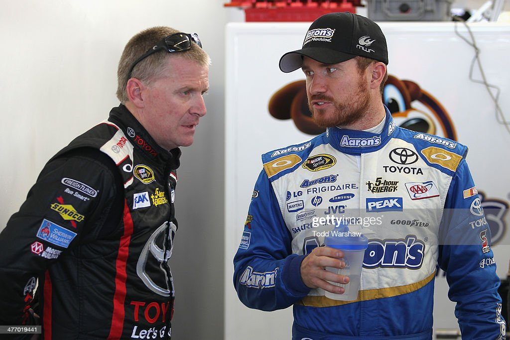 <a gi-track='captionPersonalityLinkClicked' href=/galleries/search?phrase=Jeff+Burton&family=editorial&specificpeople=216559 ng-click='$event.stopPropagation()'>Jeff Burton</a>, driver of the #66 Let's Go Places Toyota, talks with teammate <a gi-track='captionPersonalityLinkClicked' href=/galleries/search?phrase=Brian+Vickers&family=editorial&specificpeople=171225 ng-click='$event.stopPropagation()'>Brian Vickers</a>, driver of the #55 Aaron's Dream Machine Toyota, during a testing session at Las Vegas Motor Speedway on March 6, 2014 in Las Vegas, Nevada.