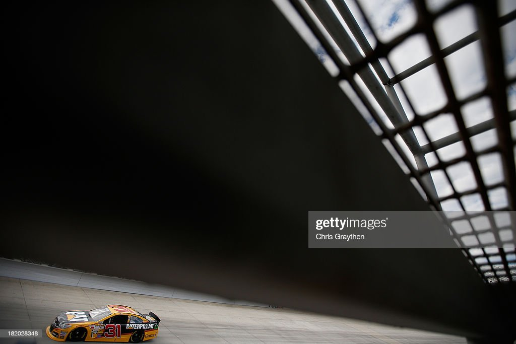 <a gi-track='captionPersonalityLinkClicked' href=/galleries/search?phrase=Jeff+Burton&family=editorial&specificpeople=216559 ng-click='$event.stopPropagation()'>Jeff Burton</a> drives the #31 Caterpillar Chevrolet during qualifying for the NASCAR Sprint Cup Series AAA 400 at Dover International Speedway on September 27, 2013 in Dover, Delaware.