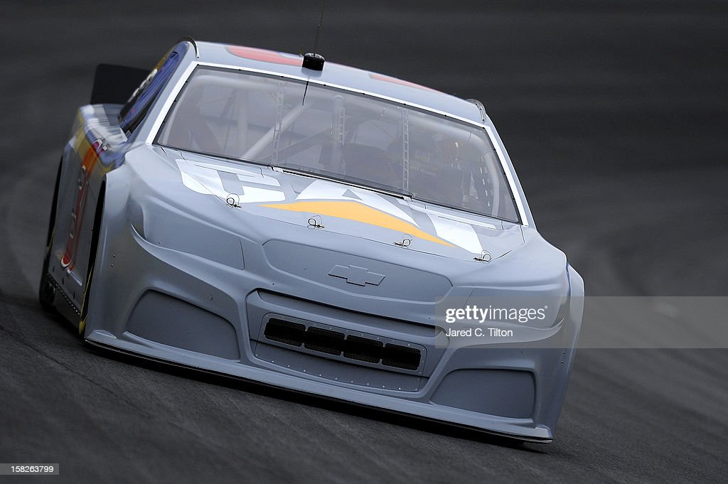 <a gi-track='captionPersonalityLinkClicked' href=/galleries/search?phrase=Jeff+Burton&family=editorial&specificpeople=216559 ng-click='$event.stopPropagation()'>Jeff Burton</a> drives the #31 Caterpillar Chevrolet during testing at Charlotte Motor Speedway on December 12, 2012 in Concord, North Carolina.