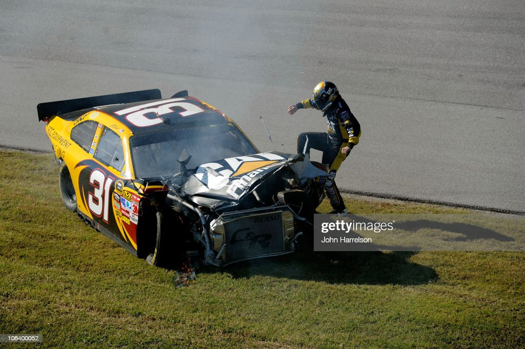 <a gi-track='captionPersonalityLinkClicked' href=/galleries/search?phrase=Jeff+Burton&family=editorial&specificpeople=216559 ng-click='$event.stopPropagation()'>Jeff Burton</a> kicks the #31 Cat Financial Chevrolet after hitting the wall in the NASCAR Sprint Cup Series AMP Energy Juice 500 at Talladega Superspeedway on October 31, 2010 in Talladega, Alabama.
