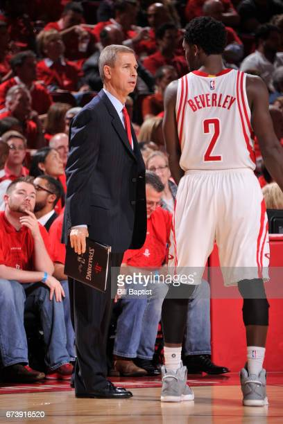 Jeff Bzdelik and Patrick Beverley of the Houston Rockets talk during Game Five of the Western Conference Quarterfinals against the Oklahoma City...