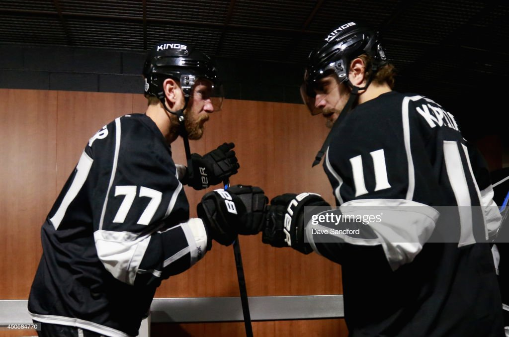 <a gi-track='captionPersonalityLinkClicked' href=/galleries/search?phrase=Jeff+Carter&family=editorial&specificpeople=227320 ng-click='$event.stopPropagation()'>Jeff Carter</a> #77 and <a gi-track='captionPersonalityLinkClicked' href=/galleries/search?phrase=Anze+Kopitar&family=editorial&specificpeople=634911 ng-click='$event.stopPropagation()'>Anze Kopitar</a> #11 of the Los Angeles Kings bump fists before taking on the New York Rangers in Game Five of the 2014 Stanley Cup Final at the Staples Center on June 13, 2014 in Los Angeles, California.