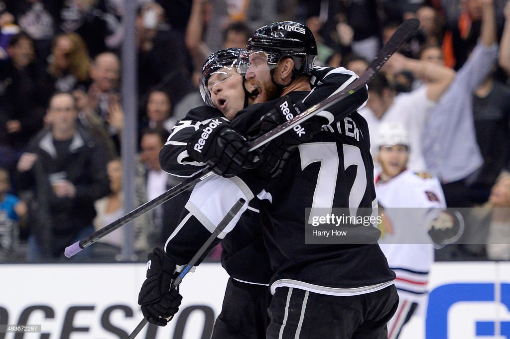 <a gi-track='captionPersonalityLinkClicked' href=/galleries/search?phrase=Jeff+Carter&family=editorial&specificpeople=227320 ng-click='$event.stopPropagation()'>Jeff Carter</a> #77 and <a gi-track='captionPersonalityLinkClicked' href=/galleries/search?phrase=Tyler+Toffoli&family=editorial&specificpeople=6514151 ng-click='$event.stopPropagation()'>Tyler Toffoli</a> #73 of the Los Angeles Kings celebrate after Carter scores a second period goal against the Chicago Blackhawks in Game Three of the Western Conference Final during the 2014 Stanley Cup Playoffs at Staples Center on May 24, 2014 in Los Angeles, California.