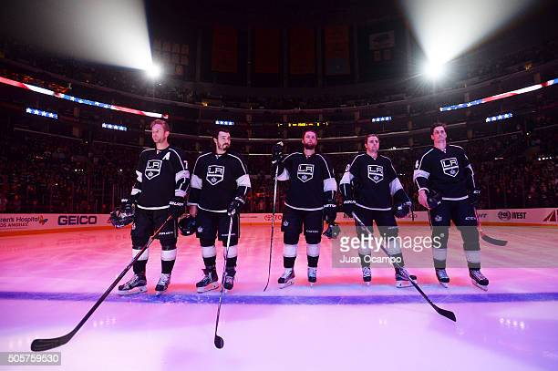Jeff Carter Drew Doughty Jake Muzzin Tanner Pearson and Vincent Lecavalier of the Los Angeles Kings listen to the national anthem before starting the...