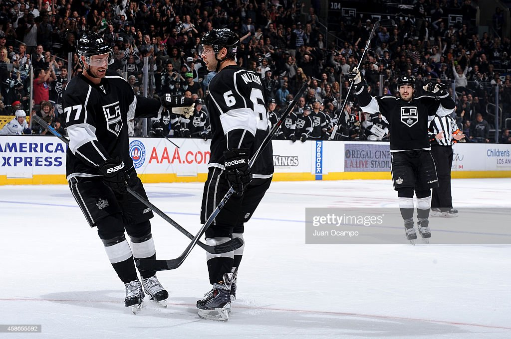 <a gi-track='captionPersonalityLinkClicked' href=/galleries/search?phrase=Jeff+Carter&family=editorial&specificpeople=227320 ng-click='$event.stopPropagation()'>Jeff Carter</a> #77, <a gi-track='captionPersonalityLinkClicked' href=/galleries/search?phrase=Jake+Muzzin&family=editorial&specificpeople=7205557 ng-click='$event.stopPropagation()'>Jake Muzzin</a> #6 and <a gi-track='captionPersonalityLinkClicked' href=/galleries/search?phrase=Drew+Doughty&family=editorial&specificpeople=2085761 ng-click='$event.stopPropagation()'>Drew Doughty</a> #8 of the Los Angeles Kings celebrate a goal during a game against the Vancouver Canucks at STAPLES Center on November 8, 2014 in Los Angeles, California.