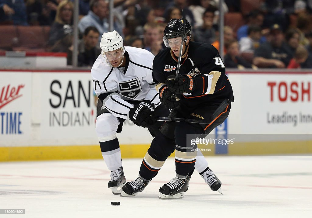 <a gi-track='captionPersonalityLinkClicked' href=/galleries/search?phrase=Jeff+Carter&family=editorial&specificpeople=227320 ng-click='$event.stopPropagation()'>Jeff Carter</a> #77 of the Los Angeles Kings and <a gi-track='captionPersonalityLinkClicked' href=/galleries/search?phrase=Cam+Fowler&family=editorial&specificpeople=5484080 ng-click='$event.stopPropagation()'>Cam Fowler</a> #4 of the Anaheim Ducks fight for the puck in the third period at Honda Center on September 17, 2013 in Anaheim, California. The Kings defeated the Ducks 6-0.