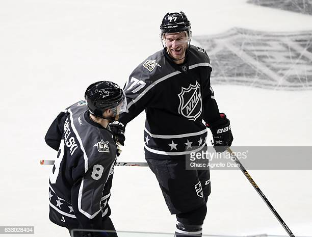 Jeff Carter of the Los Angeles Kings and Joe Pavelski of the San Jose Sharks skate during the 2017 Honda NHL AllStar Game on January 29 2017 at the...