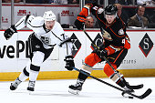 Jeff Carter of the Los Angeles Kings battles Cam Fowler of the Anaheim Ducks for the puck on November 12 2014 at Honda Center in Anaheim California