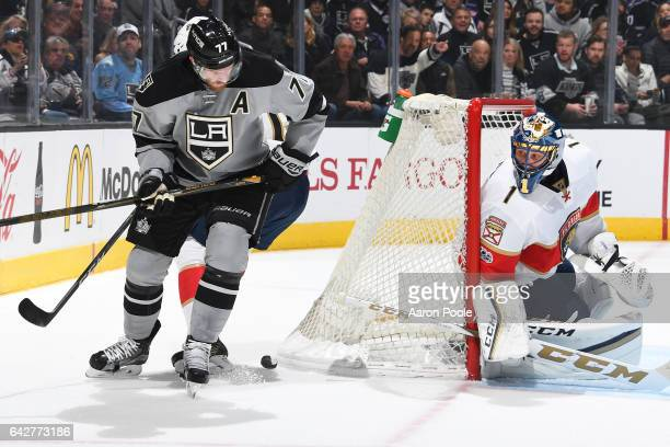 Jeff Carter of the Los Angeles Kings battles for the puck as Roberto Luongo of the Florida Panthers holds the crease during the game on February 18...