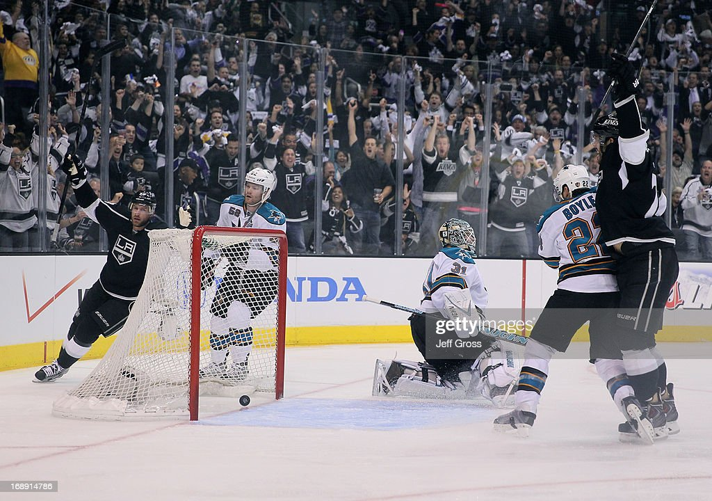 <a gi-track='captionPersonalityLinkClicked' href=/galleries/search?phrase=Jeff+Carter&family=editorial&specificpeople=227320 ng-click='$event.stopPropagation()'>Jeff Carter</a> #77 of the Los Angeles Kings celebrates a goal in the first period, as Matt Irwin #52, goaltender <a gi-track='captionPersonalityLinkClicked' href=/galleries/search?phrase=Antti+Niemi&family=editorial&specificpeople=213913 ng-click='$event.stopPropagation()'>Antti Niemi</a> #31, <a gi-track='captionPersonalityLinkClicked' href=/galleries/search?phrase=Dan+Boyle&family=editorial&specificpeople=201502 ng-click='$event.stopPropagation()'>Dan Boyle</a> #22 all of the San Jose Sharks and <a gi-track='captionPersonalityLinkClicked' href=/galleries/search?phrase=Dwight+King+-+Ice+Hockey+Player&family=editorial&specificpeople=4537297 ng-click='$event.stopPropagation()'>Dwight King</a> #74 of the Kings look on on in the first period of Game Two of the Western Conference Semifinals during the 2013 NHL Stanley Cup Playoffs at Staples Center on May 16, 2013 in Los Angeles, California. The Kings defeated the Sharks 4-3.