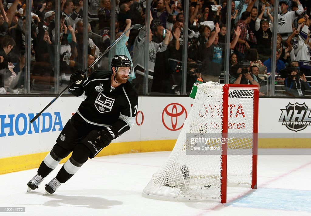 <a gi-track='captionPersonalityLinkClicked' href=/galleries/search?phrase=Jeff+Carter&family=editorial&specificpeople=227320 ng-click='$event.stopPropagation()'>Jeff Carter</a> #77 of the Los Angeles Kings celebrates a goal scored by teammate Willie Mitchell #33 (not pictured) in the second period of Game Two of the 2014 Stanley Cup Final at Staples Center on June 7, 2014 in Los Angeles, California.