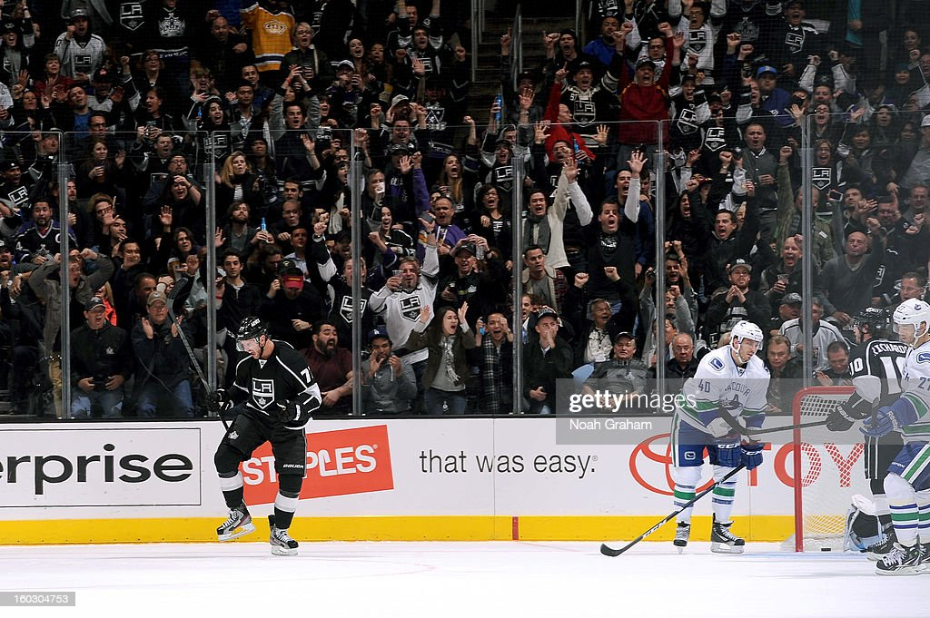 Jeff Carter #77 of the Los Angeles Kings celebrates after a goal against the Vancouver Canucks at Staples Center on January 28, 2013 in Los Angeles, California.